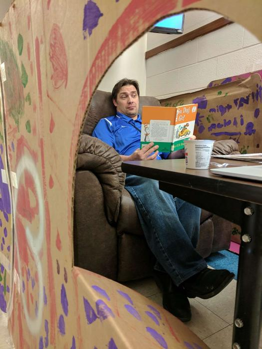 "February is ""LOVE TO READ MONTH"" Today is Dr Seuss birthday. Mr Arlint challenged the elementary students to read 1,500 book in the month of February. Our students read 1,856 books!!! So Mr Arlint is spending his day the in a box in the hallway! Way to go Mission elementary students!"